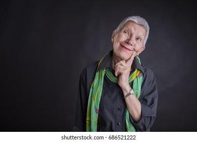 Senior old woman thinking of an idea