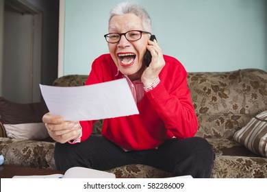 Senior old woman yelling at her bank, angry with the amount on her bills, arguing with customer service agent
