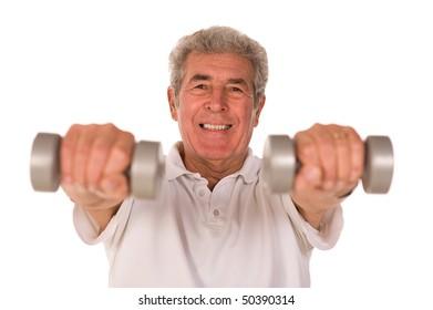 Senior older man lifting weights during gym workout session