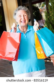 Senior on a shopping trip, excited about her bargains.