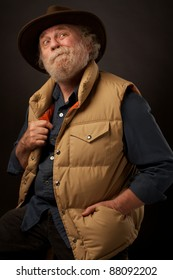 Senior outdoors man with hand in pocket