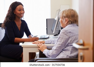 Senior Patient Having Consultation With Doctor In Office