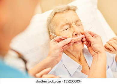 Senior as a patient with nasal cannula during an oxygen therapy in the hospital