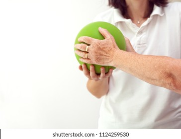 Senior patient undergoing rehabilitation with a green ball