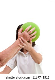 Senior patient undergoing rehabilitation with a green ball. On white background with space for your text or logo