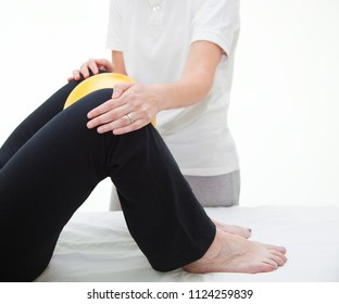 Senior patient undergoing rehabilitation with a yellow ball