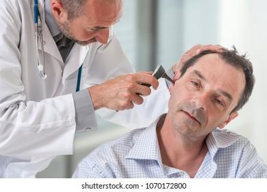 Senior patient visit otologist, ear examining