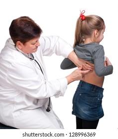 Senior pediatrician examining girl on a white background