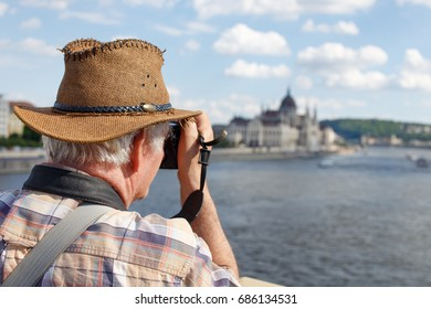 Senior pensioner tourist photographing Budapest panorama, Hungary, EU
