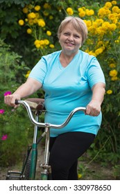 Senior pensioner woman with bicycle