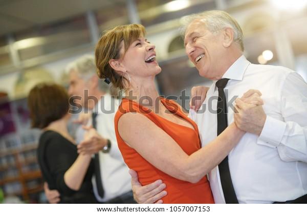 Senior people attending dance class