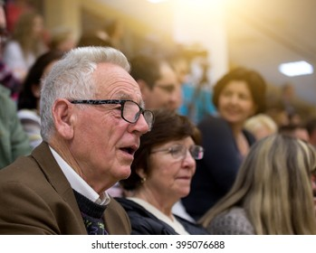 Senior people in the audience. Excited old man watching performance with open mouth