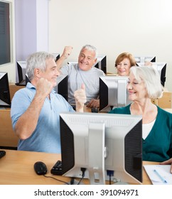 Senior People Cheering In Computer Class