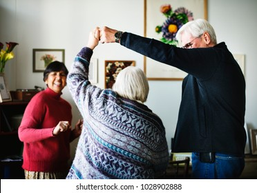 Senior people dancing together