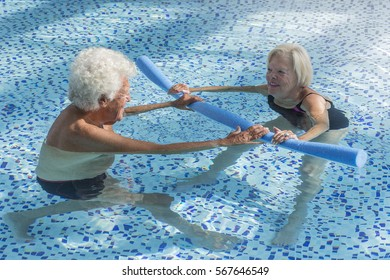 senior people doing activity in the swimming pool  with noodle