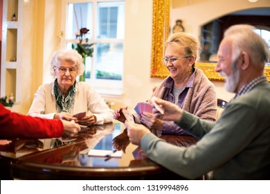 Senior people playing card games and having fun in doing so