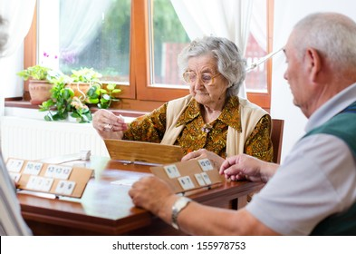 Senior people playing rummy together
