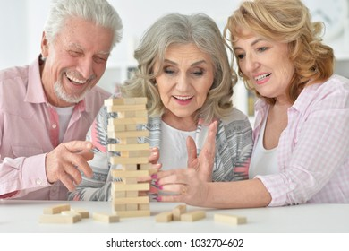 senior people playing with wooden blocks