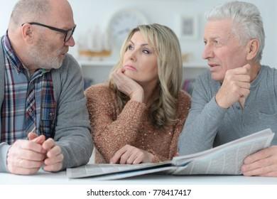 senior people reading newspaper