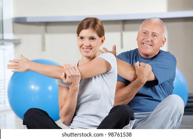 Senior people stretching their muscles in gym