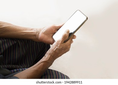 Senior people use mobile phones blank screen old mother's wrinkled hands