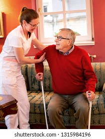Senior people with walking crutches having assistance of a loving nurse