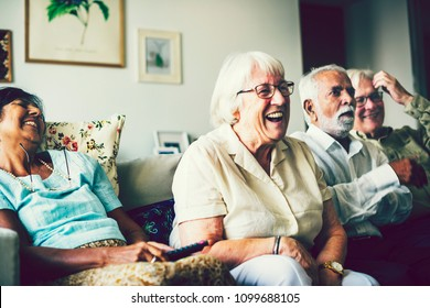 Senior people watching television in the living room