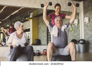 Senior people workout in rehabilitation center. Senior people with personal fitness trainer.