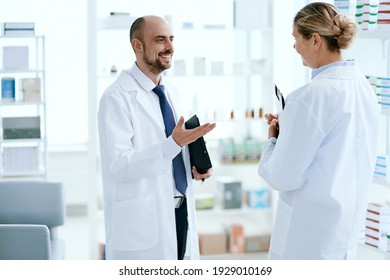 senior pharmacist discussing something with her colleague.