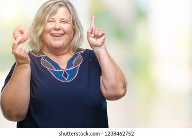 b87a38641e3 Senior plus size caucasian woman eating sugar donut over isolated background  surprised with an idea or