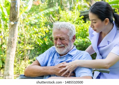 senior retirement man is heart attack while under healthcare by nurse in a garden