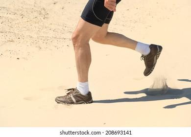 Senior runner in nature dunes