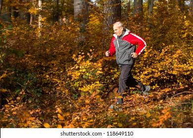 senior running through the forest