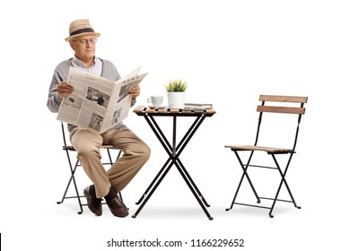 Senior sitting at a coffee table reading a newspaper isolated on white background