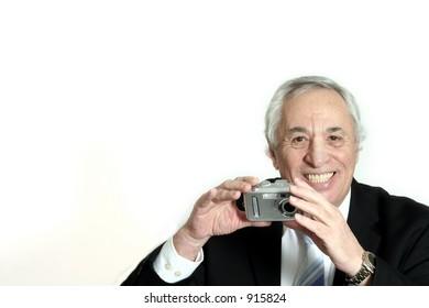 senior smiling with camera