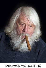 Senior - smoker with beard and cigar