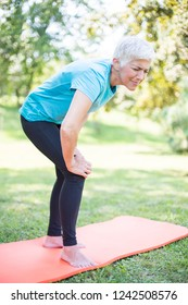 Senior sporty woman has  knee pain while workout