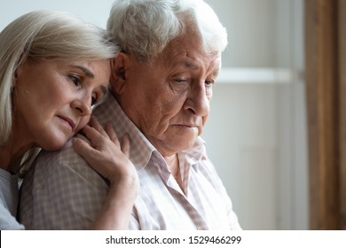 Senior spouses remember sad moments of life together, middle-aged adult daughter snuggle up to elderly father sharing his sorrows and heartache, embrace as symbol of empathy and compassion concept