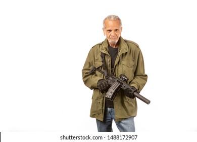 Senior survivalist, Doomsday prepper with AR15 style rifle in studio.