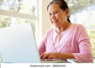 Senior Taiwanese woman working on laptop