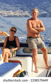 Senior tourists enjoy a catamaran excursion from Funchal, on the island Madeira in summer