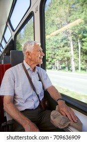 A senior is traveling by train in summertime
