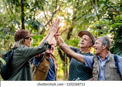 Senior trekkers giving a high five