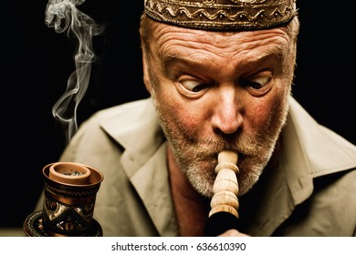 senior turkish man smoking water pipe