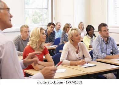 Senior tutor teaching class
