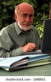 Senior Using laptop in garden