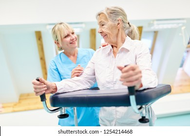 Senior with walker learning to go rehabilitation supervised by a therapist