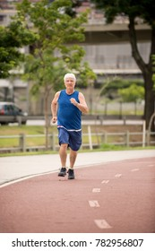 Senior walking on a street racetrack as physical activity