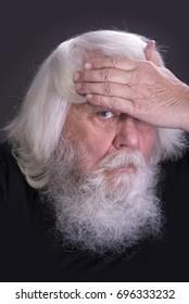 Senior, white haired man having headache isolated over greye background