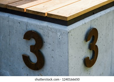 Senior winner for athletes and competitors, 3rd place. Concrete substrate, metal number, wood grade. Athletics, football, sports.